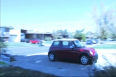 Car Backs Out of Driveway an Crashes into another Car Stock Footage