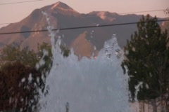 Closeup fountain with Mountains in the Background Stock Footage