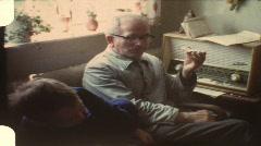 Grandpa teasing grandchildren (vintage 8 mm amateur film) Stock Footage