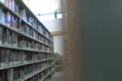 Man Searches For a book In the Isles of a Library Stock Footage