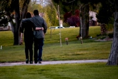 Two Teenagers In Love Walk Through the Park Stock Footage