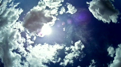 Deep blue skyscape sun and clouds Stock Footage