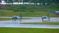 Fighter jets await their turn on the runway Stock Footage