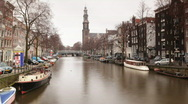 Amsterdam canal city urban boats waterway europe Stock Footage