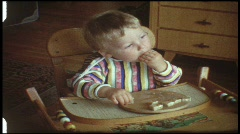 Baby eats bread (vintage 8 mm amateur film) - stock footage