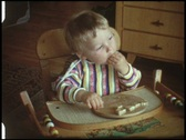 Stock Video Footage of Baby eats bread (vintage 8 mm amateur film)