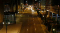 Downtown street at night time lapse - Zoom Out HD Footage
