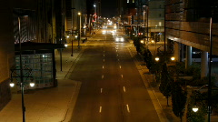 Downtown street at night time lapse - Zoom Out Stock Footage