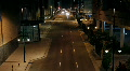 Downtown street at night time lapse - Zoom In HD Footage