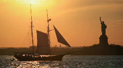 Statue of Liberty and historic sail boat Stock Footage