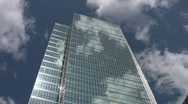 Stock Video Footage of Office tower reflects clouds. Timelapse.