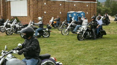 Motorcycle riders on grass park P HD 2233 Stock Footage