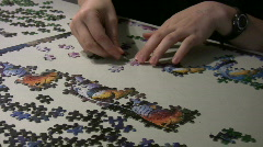 putting puzzle together - stock footage