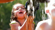 Little Girl Plays in Water Outside in Summer Stock Footage