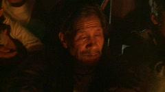 Banaue Ifugao drink around the fire 2 Stock Footage