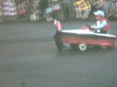 Kid in parade boat--From 1960's film Stock Footage
