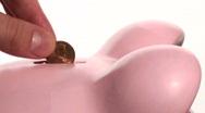 Piggy bank coin drop close-up - HD  Stock Footage