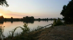 Pan of Sunrise Over River - stock footage