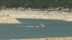 Low water boats go right lake travis Stock Footage