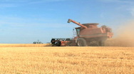 Stock Video Footage of Combine with auger arm out