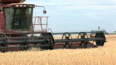 Combine close, in front of silos Stock Footage