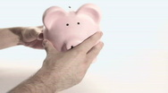 Shaking piggy bank - HD  Stock Footage