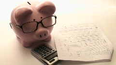 Piggy bank files taxes V2 - HD  Stock Footage