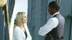 Blonde businesswoman and Afro-American businessman talking - stock footage