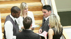 Business people discussing in corridor footage - stock footage