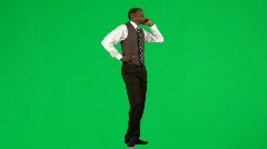 Afro-American businessman on phone against green screen Stock Footage
