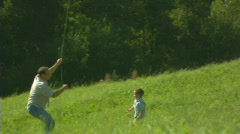 Father, child and the kite 4 - stock footage