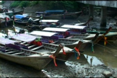 Thai Style Fishing Boats In Quiet Cove At Low Tide Stock Footage