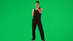 Man singing with a microphone against green screen Stock Footage