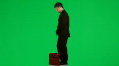 Businessman reading a report against green screen footage Stock Footage
