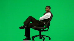 Afro-American businessman relaxing on a chair footage - stock footage