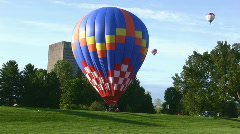 Hot Air Balloon Landing In The Park Stock Footage