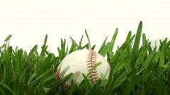 Baseball in grass Stock Footage