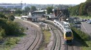 Meridian diesel passenger train passing through railway station. Stock Footage