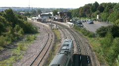 Meridian diesel passenger train passing through railway station. - stock footage