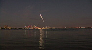 Stock Video Footage of Pyrotechnic Airplane Stunts Over Tampa's Skyline