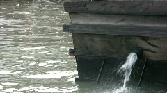 Canal Boat Purges Water Stock Footage