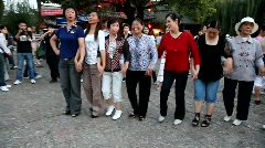 Dancing in old town square Lijiang in Yunnan province, China Stock Footage