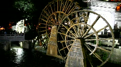 Water wheels in old town Lijiang in Yunnan province, China Stock Footage