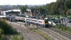 Meridian diesel passenger train leaving a railway station. Stock Footage