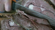 Stock Video Footage of Cutting roast beef. Closeup.