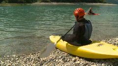 Sports and fitness, kayaker enters lake Stock Footage
