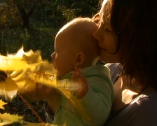 Mother and baby in the autumnal park.  - stock footage