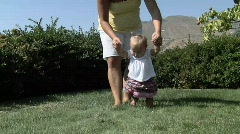Baby Girl walking outside with mom Stock Footage