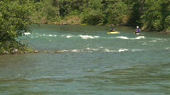 River and waterfall, whitewater raft on river with kayaks Stock Footage