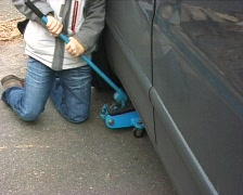 Boy trying to jack a car Stock Footage